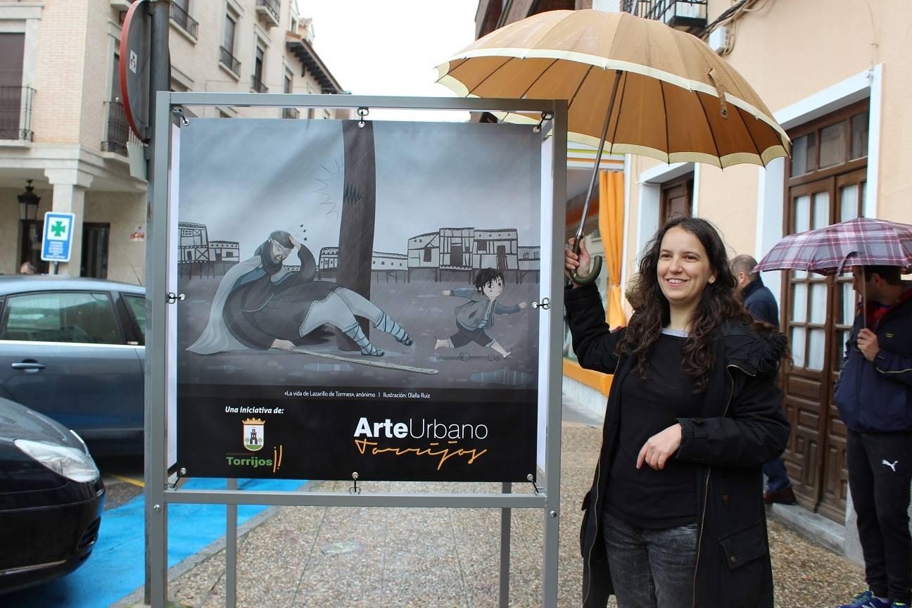 Olalla Ruiz en la Exposicion de Arte Urbano de Torrijos con ilustración del Lazarillo de Tormes