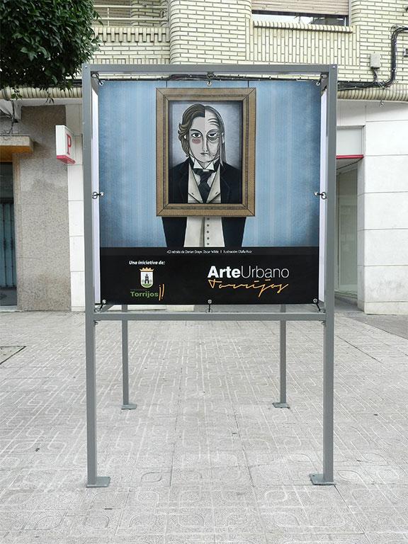 Exposición Arte Urbano en Torrijos, cubo con ilustración del retrato de Dorian Gray