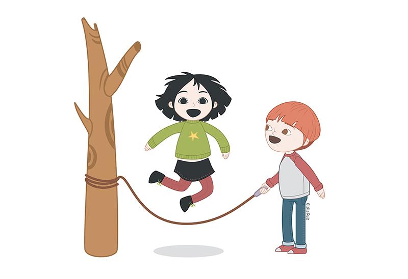 Niño y niña en un arbol saltando a la comba